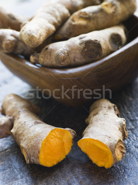 Pieces of Whole And Cracked Fresh Turmeric Root Stock photo © monkey_business