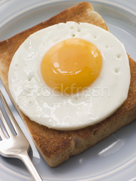 Ovo frito branco brinde comida ovo pão Foto stock © monkey_business
