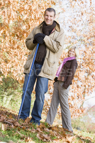 Couple clearing autumn leaves Stock photo © monkey_business
