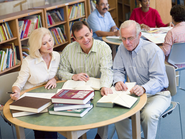 Mature students studying together in library  Stock photo © monkey_business