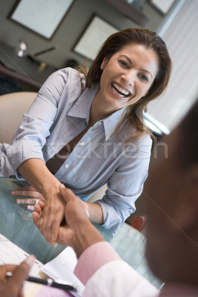 Woman shaking doctor's hand at IVF clinic Stock photo © monkey_business