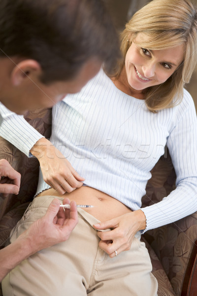 Man helping woman inject drugs to gain pregnancy Stock photo © monkey_business