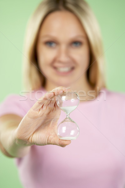 Woman Holding Hourglass Stock photo © monkey_business