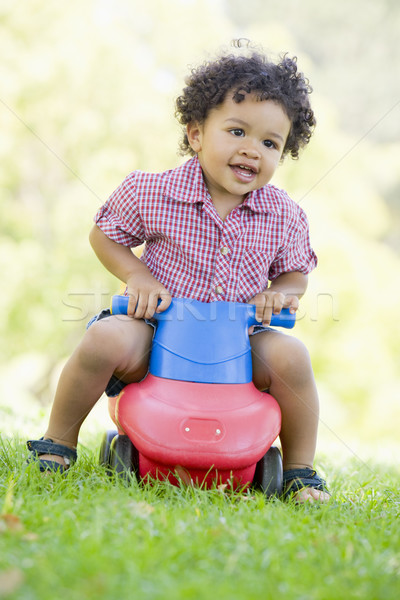 Young boy playing on toy with wheels outdoors Stock photo © monkey_business