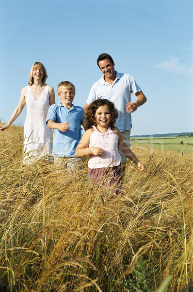 Family running outdoors smiling Stock photo © monkey_business