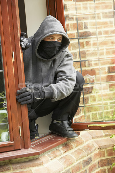 Young Man Breaking Into House Stock photo © monkey_business