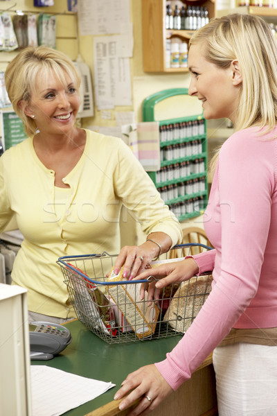 Sales assistant with customer in health food store Stock photo © monkey_business