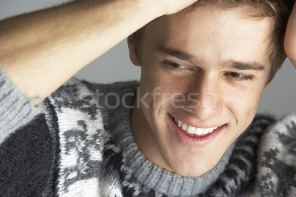 Stock photo: Portrait Of Young Man Wearing Jumper
