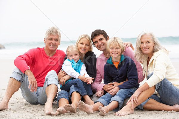 Three Generation Family Sitting On Winter Beach Together Stock photo © monkey_business