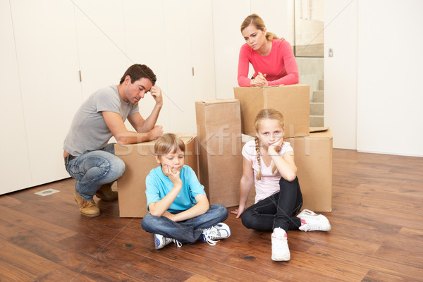 Young family looking upset among boxes Stock photo © monkey_business