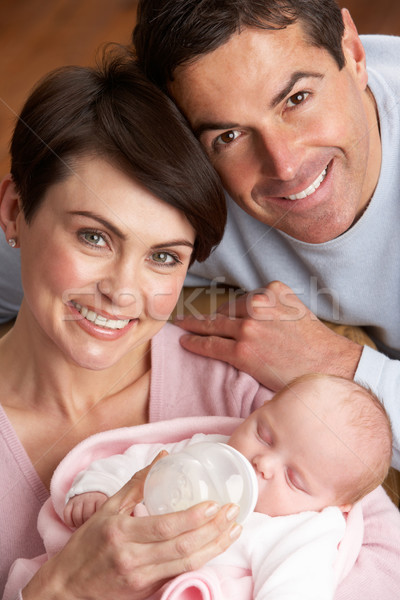 Portrait Of Parents Feeding Newborn Baby At Home Stock photo © monkey_business