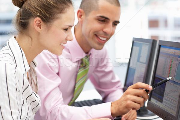бизнесмен женщину рабочих компьютеры бизнеса компьютер Сток-фото © monkey_business