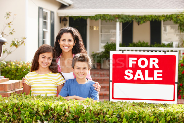 Mother and children outside home for rent Stock photo © monkey_business