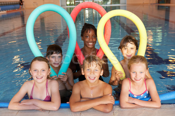 çocuklar yüzme havuzu spor arkadaşlar kızlar eğlence Stok fotoğraf © monkey_business
