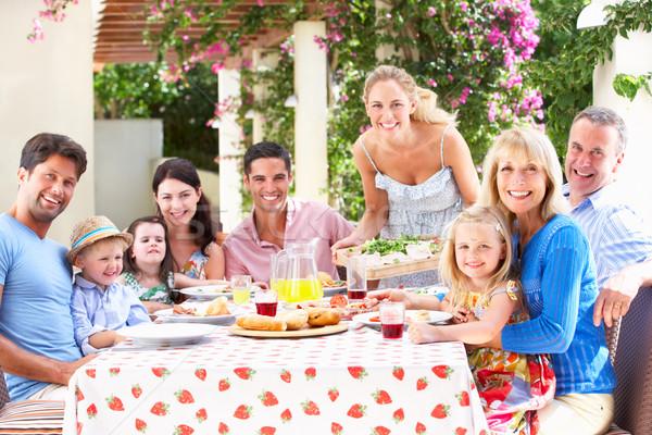 Portré többgenerációs család étel nők boldog gyermek Stock fotó © monkey_business