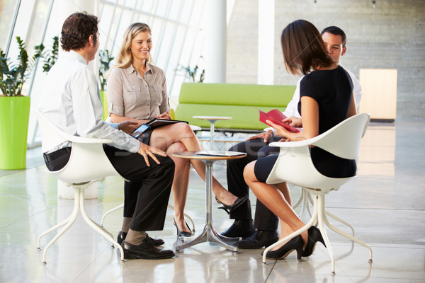 Four Businesspeople Having Meeting In Modern Office Stock photo © monkey_business