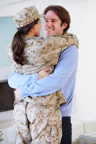 Husband Greeting Military Wife Home On Leave Stock photo © monkey_business