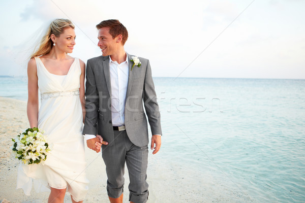 Stock photo: Bride And Groom Getting Married In Beach Ceremony