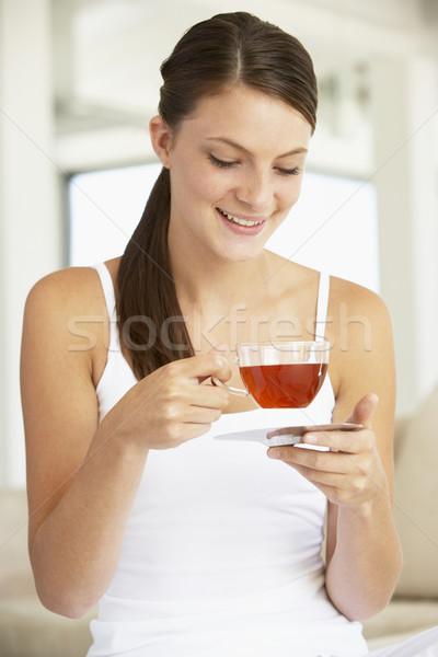 Stockfoto: Jonge · vrouw · drinken · kruidenthee · koffie · gelukkig · home