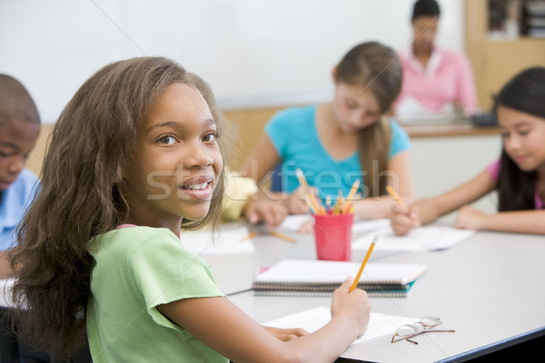 Stock photo: Elementary school pupil in classroom