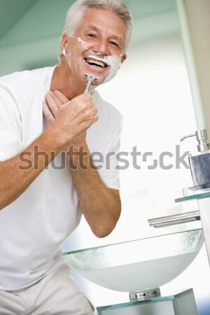 Man badkamer aftershave glimlachend sexy Stockfoto © monkey_business