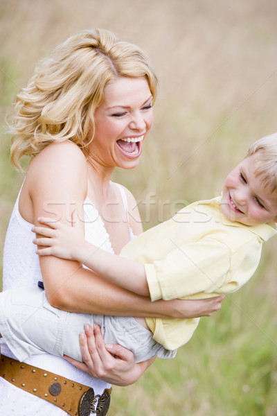 Stock photo: Mother holding son outdoors smiling