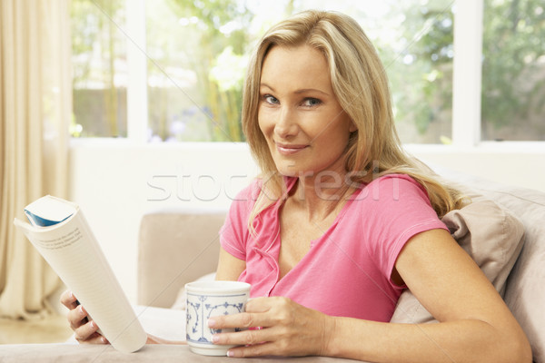 Woman Reading Book With Drink At Home Stock photo © monkey_business