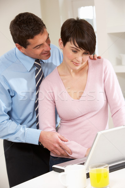 Couple Working From Home Using Laptop Stock photo © monkey_business