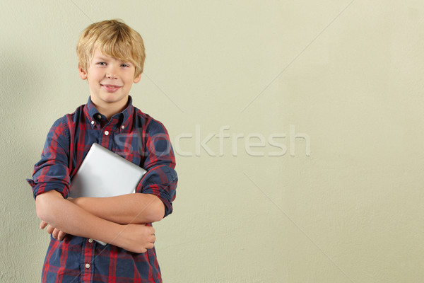 Studio Shot Of Young Boy Holding Tablet Computer Stock photo © monkey_business