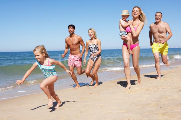Többgenerációs család élvezi tengerparti nyaralás nő család nők Stock fotó © monkey_business