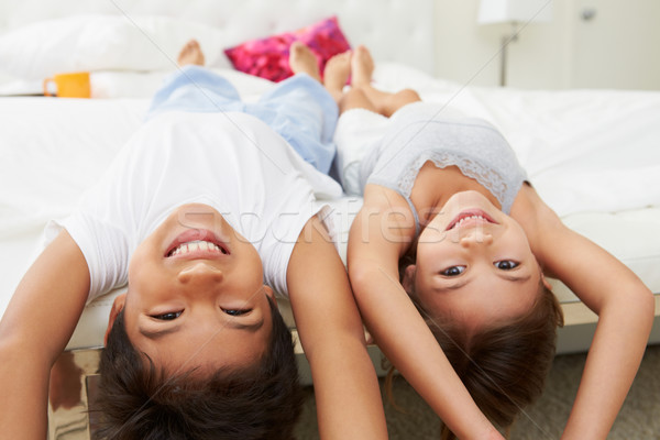 Children Lying Upside Down On Bed In Pajamas Together Stock photo © monkey_business