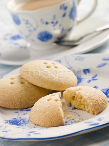 Wellington botão biscoitos copo chá beber Foto stock © monkey_business