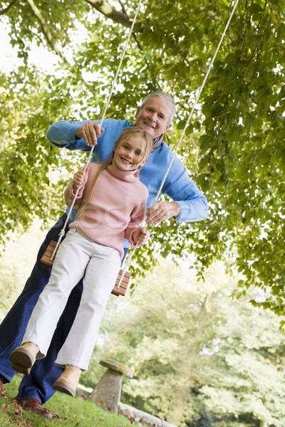 Grand-père poussant petite fille Swing jardin fille Photo stock © monkey_business