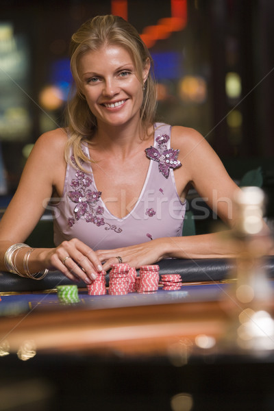Woman gambling at roulette table Stock photo © monkey_business
