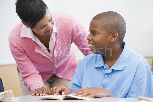 Teacher helping elementary school pupil Stock photo © monkey_business