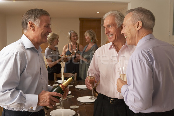 Man Serving Champagne To His Guests At A Dinner Party Stock photo © monkey_business