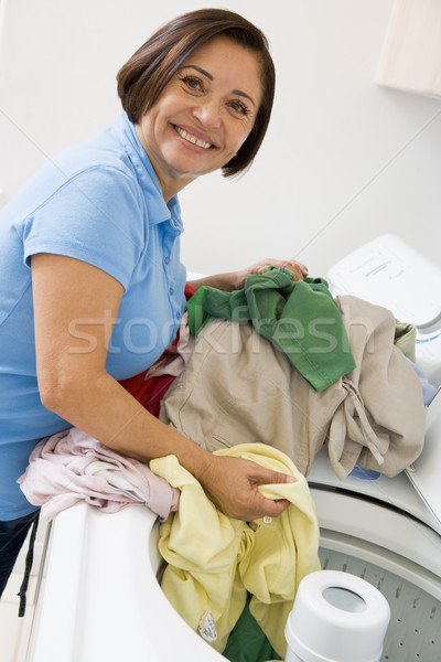 Stock photo: Woman Loading Washing Machine