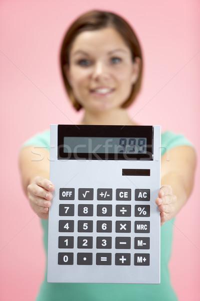 ストックフォト: 女性 · 電卓 · 背景 · 金融 · ピンク