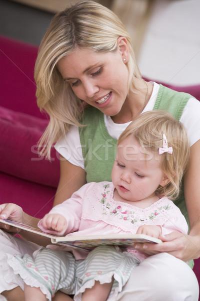 Anya nappali olvas könyv baba mosolyog Stock fotó © monkey_business