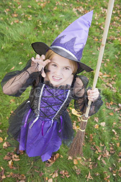 Young girl outdoors in witch costume on Halloween Stock photo © monkey_business
