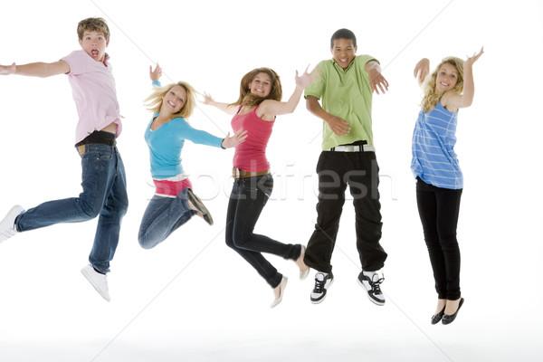 Adolescentes saltando ar grupo meninas cor Foto stock © monkey_business