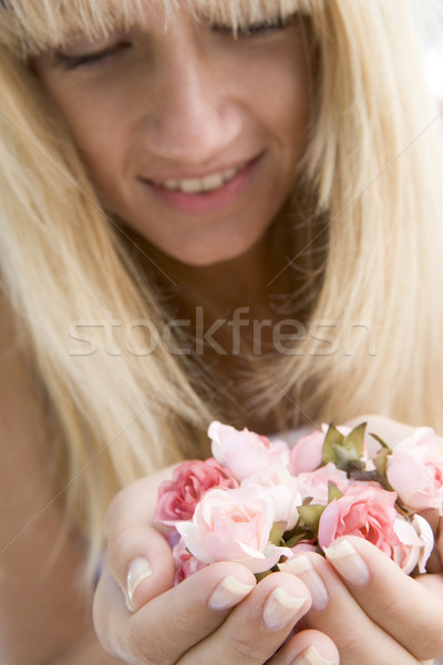 Woman holding handful of buds Stock photo © monkey_business