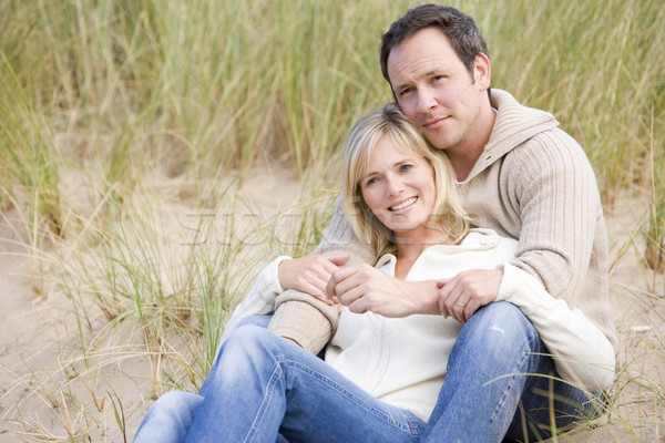 Stock photo: Couple sitting on beach smiling