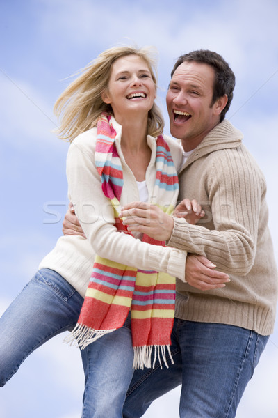 Couple standing outdoors smiling Stock photo © monkey_business