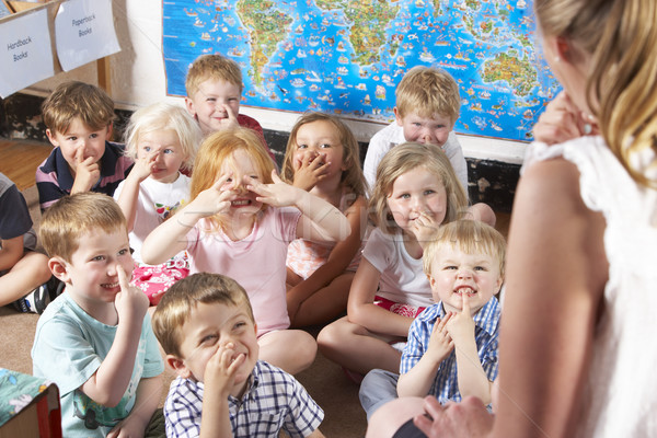 Montessori/Pre-School Class Listening to Teacher on Carpet Stock photo © monkey_business