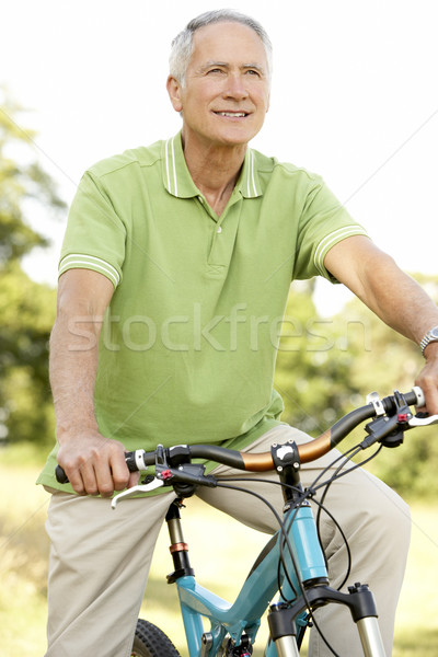 Stock photo: Portrait of man riding cycle in countryside