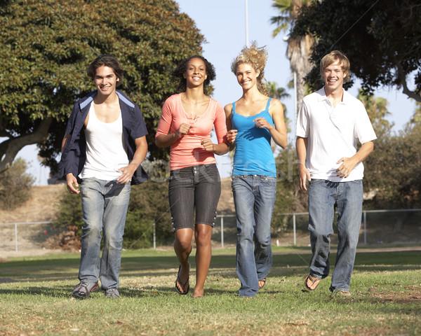 Csoport tinédzserek fut park férfi nők Stock fotó © monkey_business