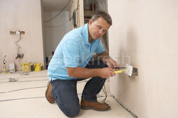 Villanyszerelő installál fal foglalat ház épület Stock fotó © monkey_business
