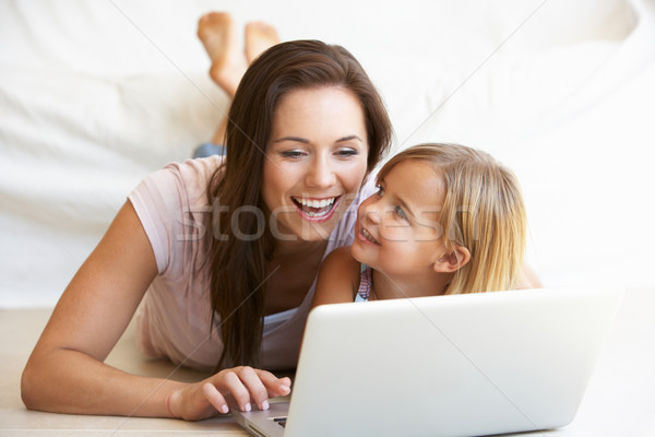 Young woman with girl using laptop computer Stock photo © monkey_business