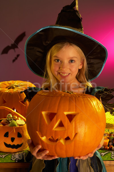 Halloween party with a child holding carved pumpkin Stock photo © monkey_business